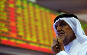 epa04895961 A Gulf investor reacts while following the stock market developments on a monitor screen at the Dubai Financial Market, Dubai, United Arab Emirates, 24 August 2015. Global shares plunged 24 August after stocks in Shanghai crashed as a global market sell-off took hold amid growing fears about the state of China's economy. The sharp falls in stocks around the world came in the wake of growing investor concerns about the threat posed to global growth by the economic slowdown under way in China - the world's second biggest economy.  EPA/ALI HAIDER