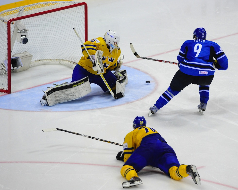 Finland's Mikko Koivu (R) fails to score through Sweden's goalkeeper Viktor Fasth during their IIHF Ice Hockey World Championship final match between Sweden and Finland in Bratislava city on May 15, 2011. AFP PHOTO / JOE KLAMAR (Photo credit should read JOE KLAMAR/AFP/Getty Images)